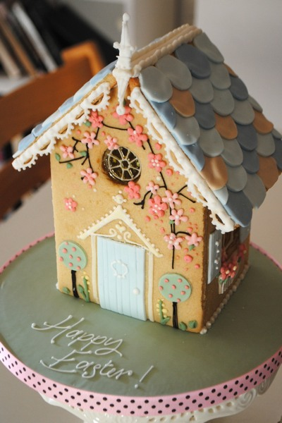 Consider a centrepiece like this iced biscuit house for your spring and summer party.