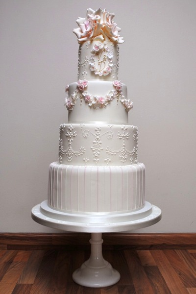 This design was inspired by the wedding flowers and 18th century architecture of the venue, Bath's Assembly Rooms.