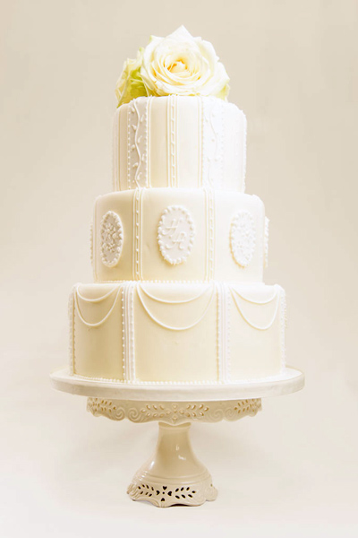 Minett Classic and architectural, this style brings traditional wedding cake design bang up to date. Choose background colours to reflect your theme.