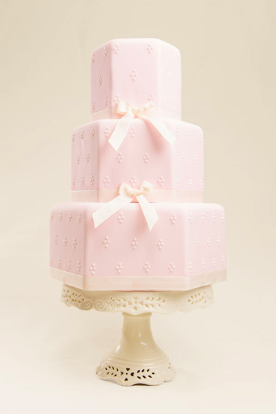 Nicola Simple and picture-pretty, this sugar pink hexagonal cake will make a wonderful centrepiece for your wedding celebration.